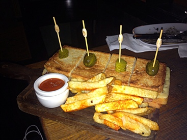 Triple Pork, double decker toasted cheese sandwich with bravas fries